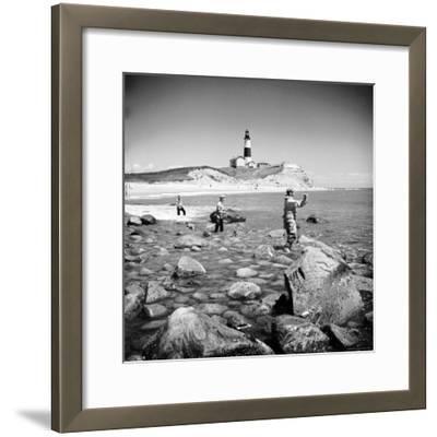 Surf Casting Fishermen Working the Shore Near the Historic Montauk Point Lighthouse