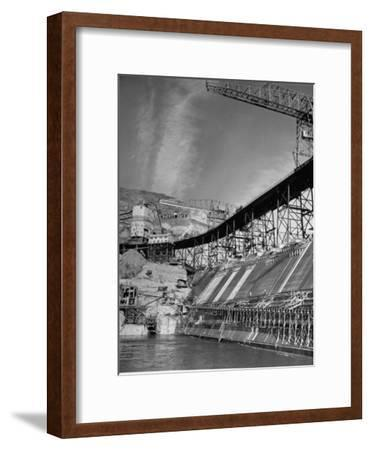 """The Grand Coulee Dam under Construction with a Sign in the Bkgrd. That Says: """"Safety Pays"""""""