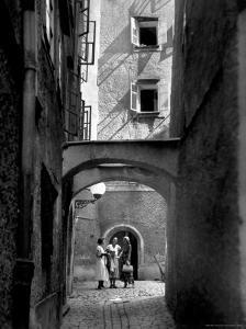 Three Young Women Chatting in Cobbled Alleyway of Old Section of Salzburg by Alfred Eisenstaedt