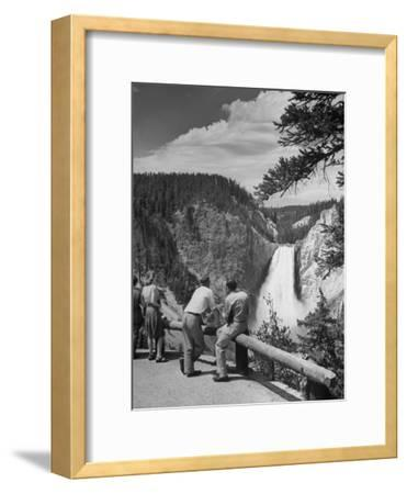 Tourists Viewing Waterfall in Yellowstone National Park
