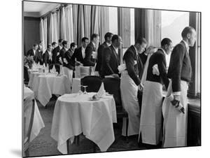 Waiters in the Grand Hotel Dining Room Lined Up at Window Watching Sonia Henie Ice Skating Outside by Alfred Eisenstaedt