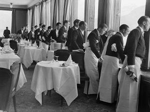 Waiters in the Grand Hotel Dining Room Lined Up at Window Watching Sonja Henie Ice Skating Outside by Alfred Eisenstaedt