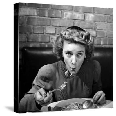 Woman Eating Spaghetti in Restaurant. No.5 of Sequence of 6