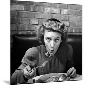 Woman Eating Spaghetti in Restaurant. No.5 of Sequence of 6 by Alfred Eisenstaedt