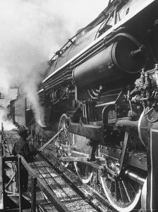 Worker Cleaning Train Engine in Yard at Union Station by Alfred Eisenstaedt
