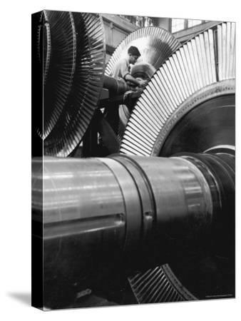 Workman on Large Wheel That Looks Like Fan, at General Electric Laboratory