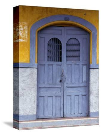 A Smokey Grey Wooden Door of a Painted Colonial House, Granada,Granada, Nicaragua