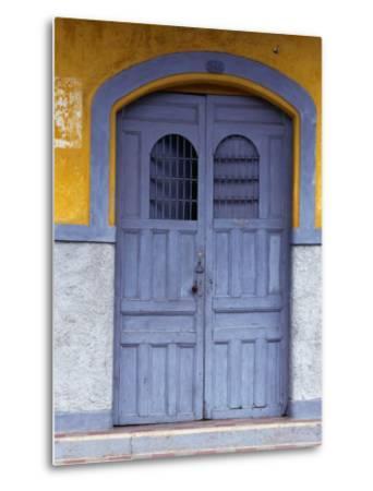 A Smokey Grey Wooden Door of a Painted Colonial House, Granada,Granada, Nicaragua
