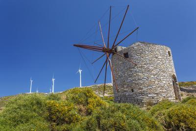 Old Windmill and Modern Wind Turbines. Naxos Island, Greece