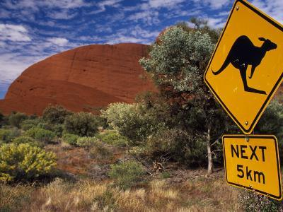 Alice Springs, Traffic Sign Beside Road Through Outback, Red Rocks of Olgas Behind, Australia-Amar Grover-Photographic Print