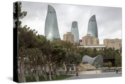 Azerbaijan, Baku. A Park in Baku with the Flame Towers in the Distance