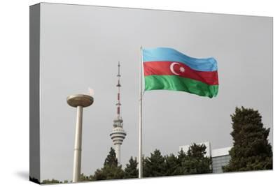 Azerbaijan, Baku. an Azerbaijan Flag Waves Near a Memorial Flame and the Baku Tv Tower