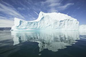 Greenland, Scoresby Sund, Red Island, Large Iceberg in a Small Ripple of Water by Aliscia Young