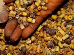 Beadmaker Displaying Samples, Asameng, Ghana by Alison Jones
