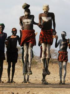 Men Wearing Traditional Body Paint in Nyangatom Village Dance, Omo River Valley, Ethiopia by Alison Jones