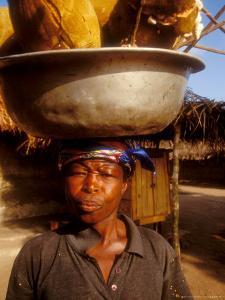 Woman Carrying Pan Filled with Baobab Fruit, Boku, Ghana by Alison Jones