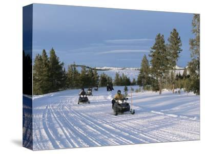 Snowmobiling in the Western Area of Yellowstone National Park, Montana, USA