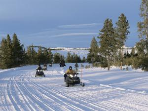 Snowmobiling in the Western Area of Yellowstone National Park, Montana, USA by Alison Wright
