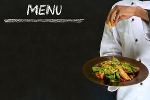 Chef with Healthy Salad Food on Chalk Blackboard Menu Background by alistaircotton