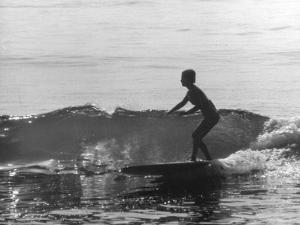 16 Yr. Old Surfer Kathy Kohner Riding a Wave by Allan Grant