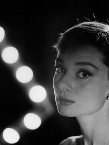 Actress Audrey Hepburn Backlit by V Pattern of 6 Klieg Lights by Allan Grant