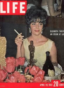 Actress Elizabeth Taylor with her Academy Award at an Oscar Party Following her Win, April 28, 1961 by Allan Grant