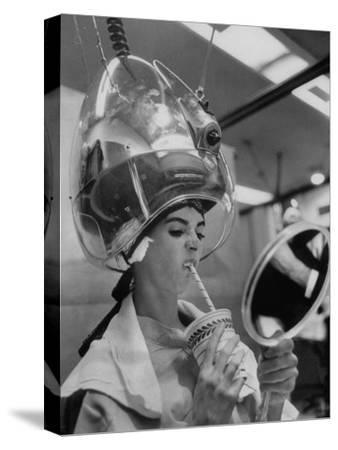 Actress Millie Perkins Making Faces at Herself in Mirror While Getting Hair Done in Beauty Salon