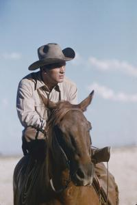 American Actor Rock Hudson on a Horse During the Filming of 'Giant', Near Marfa, Texas, 1955 by Allan Grant