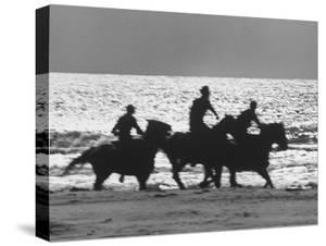 American Visitors Enoying Horseback Riding on Rosarita Beach by Allan Grant