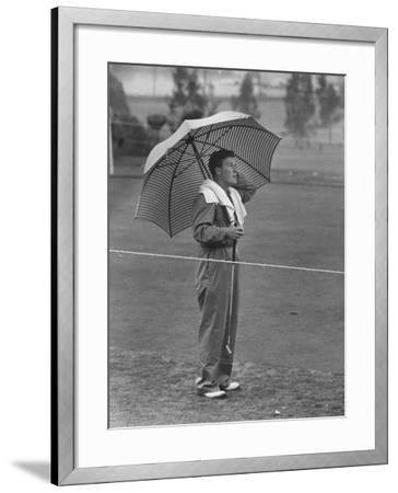 Australian Golfer Peter Thompson, Standing under Oversized Umbrella During the Los Angeles Open