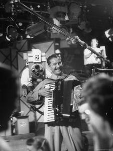 Bandleader Lawrence Welk Playing Accordion Amidst Cameramen on the Set of Weekly TV Show by Allan Grant