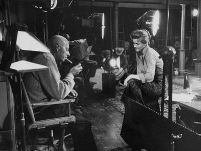 """Director Howard Hawks Conferring with Actress Angie Dickinson on Set for """"Rio Bravo"""""""