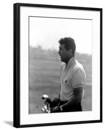 Entertainer Dean Martin Playing Golf