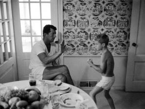 Entertainer Dean Martin Sparring with His Son at Home by Allan Grant