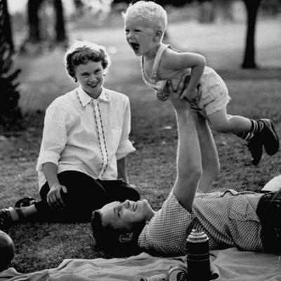 Father Playing with His Child During a Picnic