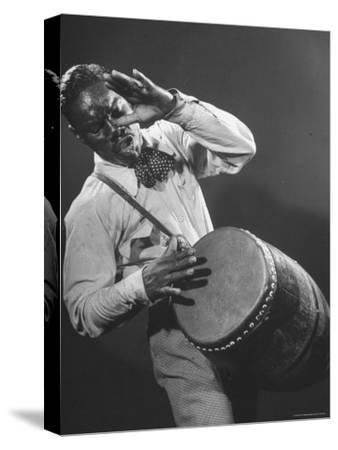 Good of Jungle Type Drum Being Played by Drummer of Dizzy Gillespie's Band