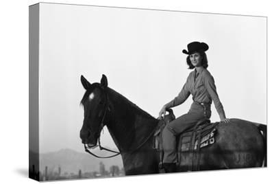 Lee Archer, 24, Riding a Horse at O.B. Llyod Stables in Scottsdale, Arizona, October 1960