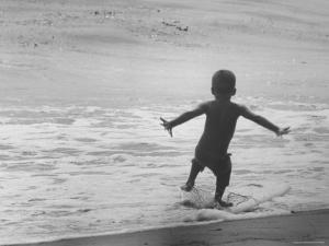 Little Boy Trying to Surf by Allan Grant
