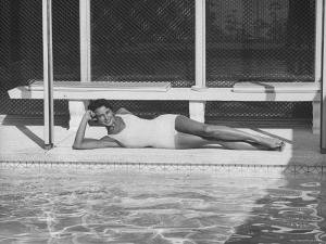 Model Posing Near a Pool by Allan Grant