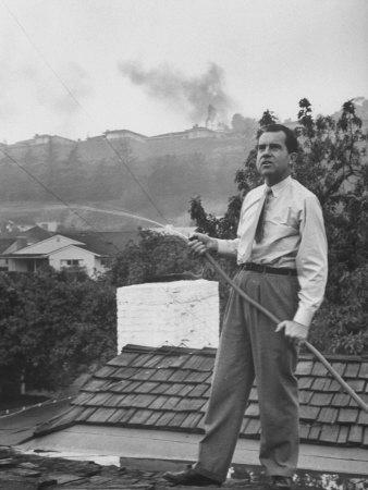 Senator Richard M. Nixon on Roof of Home in Los Angeles, Putting Out Fires Caused by Brush Blaze
