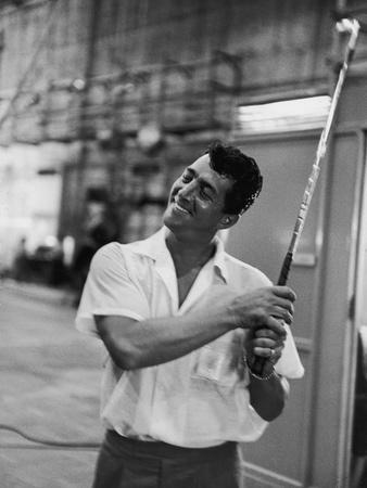 Singer and Actor Dean Martin with Golf Club on Movie Set for Mgm's 'Some Came Running', 1958