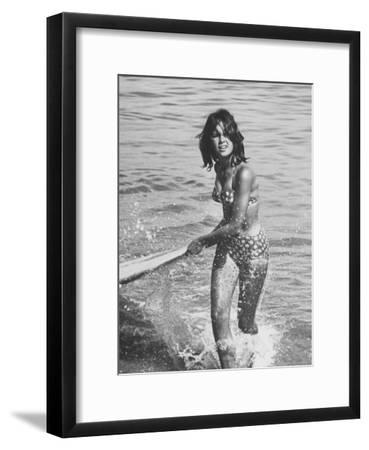 Surf Rider Returning After Surfing