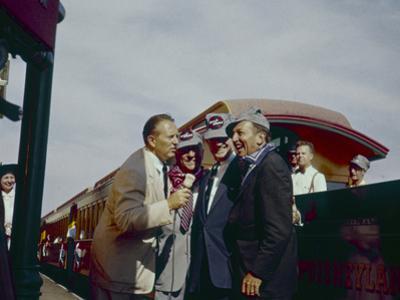 Walt Disney Being Interviewed by Train at Disneyland. Anaheim, California 1955 by Allan Grant