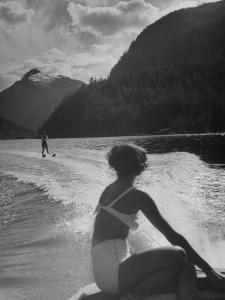 William Holden Water Skiing While His Wife Brenda Watches Him by Allan Grant