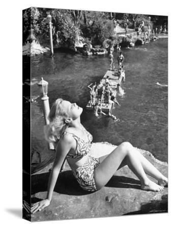 Young Girl Sunbathing at the Venetian Pool