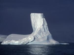 Penola Strait, Pleneau Island, Columnar Iceberg in Evening Light, Antarctica by Allan White