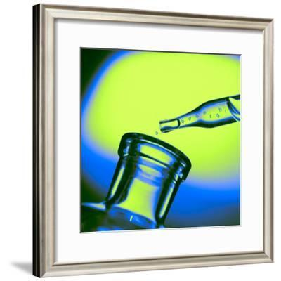 Alphabet Letters Dropping from Glass Pipette into Glass Bottle--Framed Photographic Print