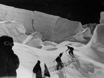 Alpinists Walking in the Snow--Photographic Print