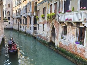 A Gondola on a Canal in Venice, UNESCO World Heritage Site. Veneto, Italy, Europe by Amanda Hall