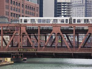 An El Train on the Elevated Train System Crossing Wells Street Bridge, Chicago, Illinois, USA by Amanda Hall